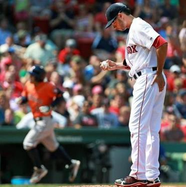 After a double-play call was overturned to keep the second inning alive, Joe Kelly allowed a grand slam to Jose Altuve.